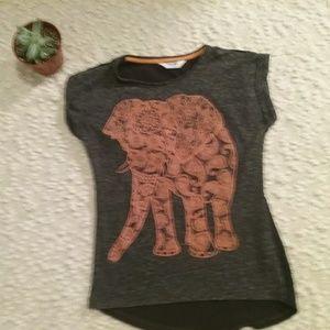 A elephant print gray shirt.
